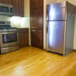 Rented! $1300/mo 2BR/1BA in McKinley Park on the boulevard by Orange Line! Vintage w/updates! Eat-in kitchen, stainless steel, dishwasher, AC, dining room, hutch, armoire, fenced-in yard, laundry, storage