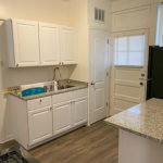 Rented! $1200/mo 2BR/1BA Rehab with decorative fireplace, king- and queen-sized bedrooms, hardwoods, deck, more!